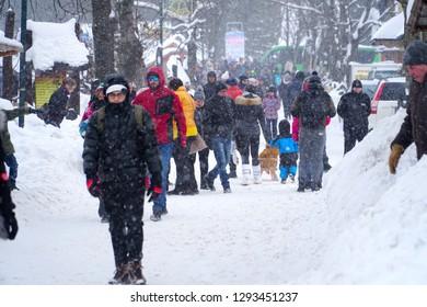Zakopane/Poland - 13 January 2019: Polish people walking  in snow storm in Zakopane, Poland. Zakopane in winter.