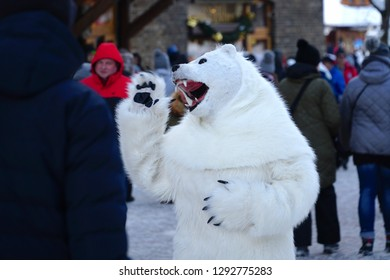 Zakopane/Poland - 13 January 2019: Street performance in Krupowki street, Zakopane. A man in bear fancy dress costume entertains a crowd of people in the Tatra mountains, Poland.
