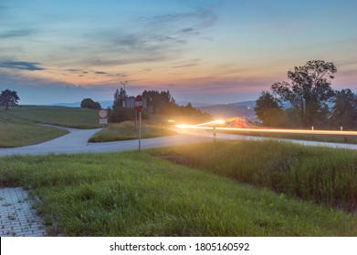 Zakopianka road with car light trail in Chabowka at susnet time.