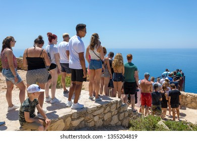 ZAKYNTHOS, GREECE - JULY 21, 2018: Tourists in a que to take a photo of a famous beach with shipwreck in Zakynthos island