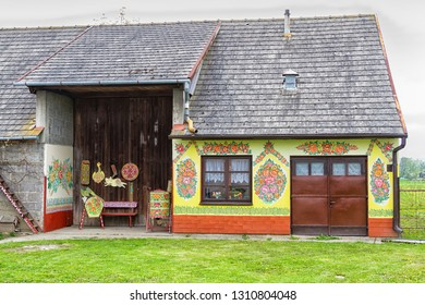 ZALIPIE, POLAND - APR 30, 2016: Facade of a traditional colorful building in Zalipie village in Poland. Zalipie is a very small village in southern Poland famous from painted houses with flower motifs