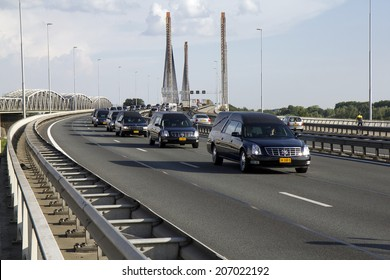 ZALTBOMMEL, THE NETHERLANDS - 24 JULY 2014. A procession of hearses crosses the Martinus Nijhoff bridge on the A2 highway, carrying victims of the crash of Malaysian Airlines flight 17 in Ukraine.