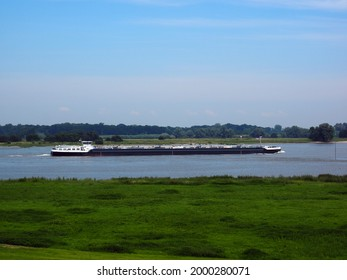Zaltbommel, the Netherlands - June, 27, 2021: A  gas ship on the river Waal near Zaltbommel in The Netherlands. The Waal river is the major waterway between the port of Rotterdam to Germany.