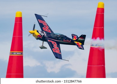 ZAMARDI / HUNGARY - JULY 13, 2019: Peter Besenyei with N806CR Corvus Racer flying over Lake Balaton at Zamardi city for Red Bull Air Race 2019