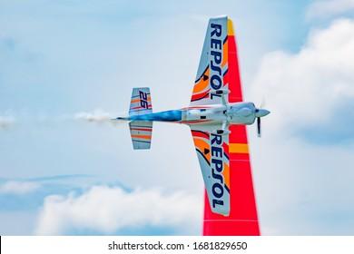 ZAMARDI / HUNGARY - JULY 13, 2019: Juan Velarde with N26VE Zivko Edge 540 flying over Lake Balaton at Zamardi city for Red Bull Air Race 2019