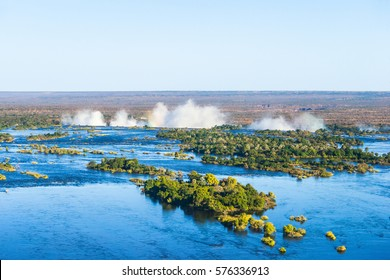 Zambezi river and Victoria falls, the largest curtain of water in the world, view from helicopter.