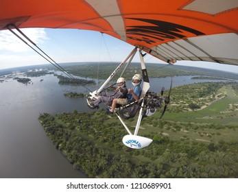 Zambia, 9 January, 2018. Flying on Microlight Plane over Zambezi River with Victoria Falls on Horizon on 9 January, 2018.