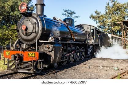 ZAMBIA, LIVINGSTON, AFRICA â?? 18 JULY: Old steam locomotive in royal Zambia in Livingston.  Africa, Zambia, Livingston. July 18, 2014.