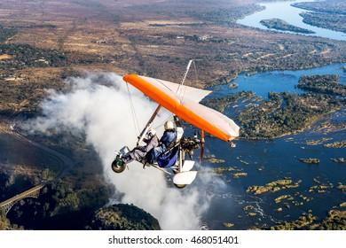 ZAMBIA, VICTORIA FALLS, AFRICA â?? 18 JULY: Tourists fly over the Victoria Falls on the trikes. Africa, Zambia, Victoria Falls. July 18, 2014.