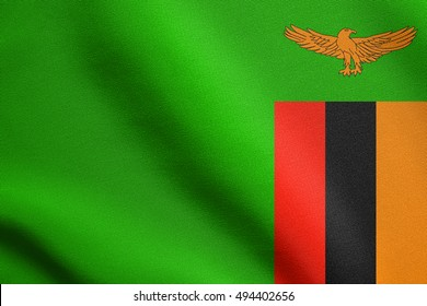 Zambian national official flag. African patriotic symbol, banner, element, background. Accurate dimensions. Correct size, colors. Flag of Zambia waving in the wind with detailed fabric texture, 3d