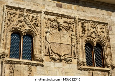 ZAMORA, SPAIN - JULY 20, 2019: The Palace of the Momos is a Renaissance building, but with a profuse decoration with elements of Elizabethan Gothic. Detail of the crowning of the main cover.
