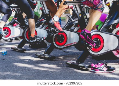 Zamora, Spain - September 02, 2017: People perform a spinning session outdoors in an urban park. Cycle Against Cancer. Organized by the Spanish Association Against Cancer of Zamora. Spain.