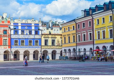ZAMOSC, POLAND, 30 AUGUST 2018: Beautiful coloured architecture in the main square