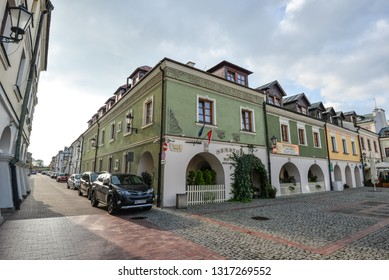 Zamosc, Poland - August 23, 2017: View on bright buildings of little town Zamosc, Poland