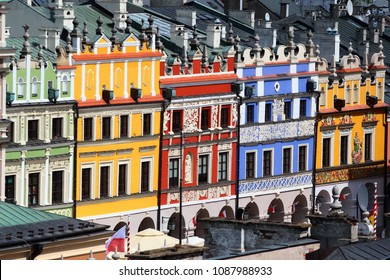 Zamosc, Poland - May 1, 2018: Facades of old colorful buildings on historical Great Market Square in the center of Old town of Zamosc, a UNESCO World Heritage Site.