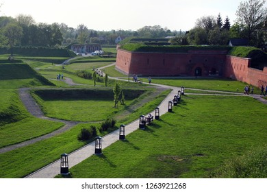 Zamosc, Poland - May 1, 2018: Red brick walls and bastions of old Zamosc fortress, the Unesco World Heritage Site and a popular tourist destination in Eastern Poland.