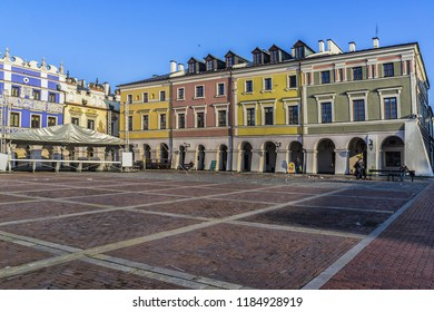 "ZAMOSC, POLAND - NOVEMBER 27, 2015: Zamosc Market Square. Zamosc - example of a Renaissance town in Central Europe, designed with Italian theories of ""ideal town"", UNESCO World Heritage List."