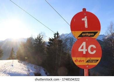 Zams Austria, 24-2-20: sign for red piste against blue sky in ski resort venet.