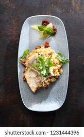 Zander. An exquisite dinner dish. A portion of fish served on a risotto with sun-dried tomatoes.