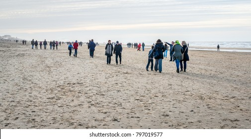 ZANDVOORT AAN ZEE, NETHERLANDS - JANUARY, 5 : Many unknown people walk on a sunny but cold winter day on the North Sea beach at the Dutch seaside resort Zandvoort aan Zee on January 5, 2014