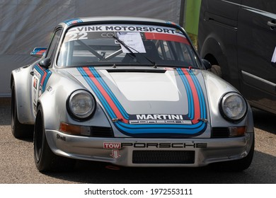 ZANDVOORT,HOLLAND - 18 MEI 2019: Front of a vintage gray metallic with sport stripes  fast porsche 911
