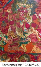Zang Dhok Palri Phodang, India - Jan 02, 2012: Dharmapala wrathful deity colorful wall painting, spiritual and ritual symbol of Buddhism, in Lava monastery in Kalimpong, West Bengal, India