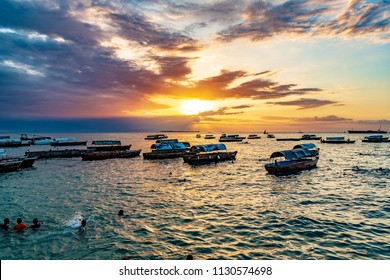 ZANZIBAR CITY, TANZANIA - August 13, 2017: Sunset in Stone Town, Zanzibar, Tanzania. Zanzibar is a semi-autonomous region of Tanzania in East Africa.