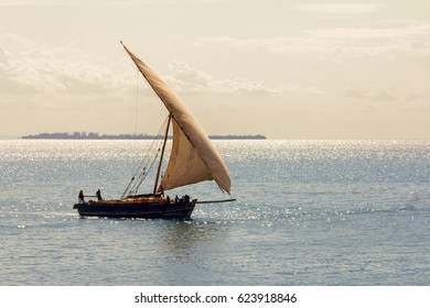 zanzibar dhow transport vessel arriving with a cargo delivery at a port