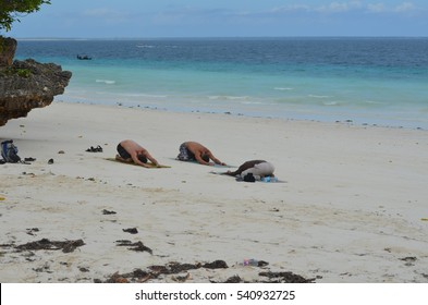 Zanzibar Island Africa August 20 Two men do yoga with their trainer on Nungwi beach