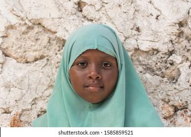 Zanzibar, Tanzania - december 09, 2019 : Unidentified african girl near a local school after class in island Zanzibar, Tanzania, East Africa