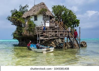 "ZANZIBAR, TANZANIA - January 2018: Famous ""The Rock"" restaurant built on the cliff in the sea at Zanzibar, Tanzania"