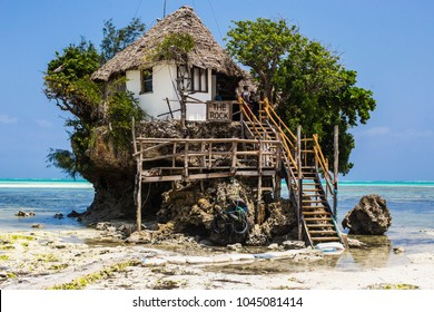 "ZANZIBAR, TANZANIA - January 2018: Famous ""The Rock"" restaurant built on the cliff in the sea at Zanzibar, Tanzania"