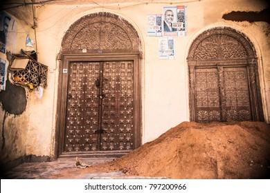 ZANZIBAR, TANZANIA - January 2018: Traditional wooden Zanzibar doors with artistic carving and typical Zanzibar design.