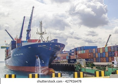ZANZIBAR, TANZANIA - JUNE 16: huge container ship moored in the harbor of Stone Town on June 16, 2013 in Zanzibar. Stone town is one of the main harbor of Africa