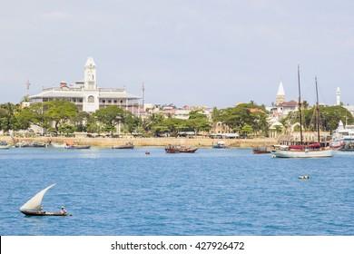 ZANZIBAR, TANZANIA - JUNE 16: small vessel sailing in front of Stone Town on June 16, 2013 in Zanzibar. Stone Town is the old part of Zanzibar City, the main city of Zanzibar
