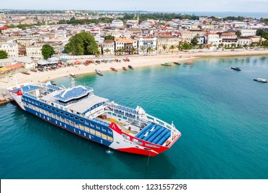 Zanzibar, Tanzania - May 05, 2018: Ro-Ro/Passenger ship Azam Sea Link 2. New ferry to Pemba or  Dar es Salaam loading, ready to depart. Stone Town, Zanzibar City, Unguja island, Tanzania. Aerial photo
