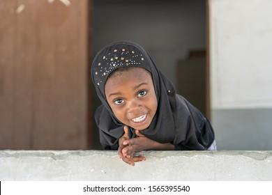 Zanzibar, Tanzania - november 11, 2019 : Unidentified african girl near a local school after class in island Zanzibar, Tanzania, East Africa