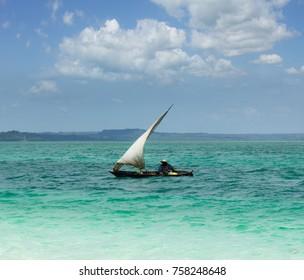 Zanzibar.Ffisherman go for fishing on a traditional boat