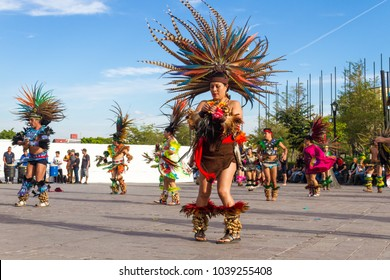 Zapopan, Jalisco / Mexico - February 25 2018: A woman dances traditional aztec music during a cultural festival. The festival was about cultural synergy and takes place each year during february.