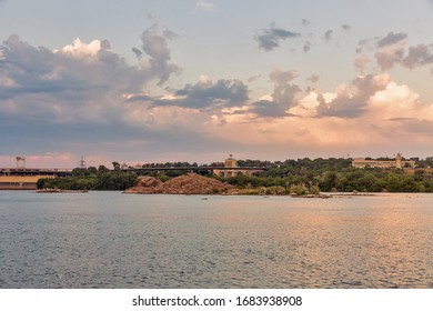 Zaporizhia cityscape and Dnieper River at sunset, Ukraine. Dnipro hydroelectric power plant dam in the background.