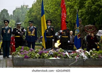 ZAPORIZHIA, UKRAINE – May 9, 2015: Veterans of World War II lay flowers to memorial of victory in ZAPORIZHIA, UKRAINE