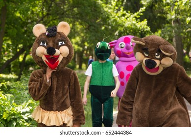 Zaporizhia/Ukraine- May 28, 2017: Charity Family festival - children entertainers in animal and fairy characters costumes walking in a park before performance