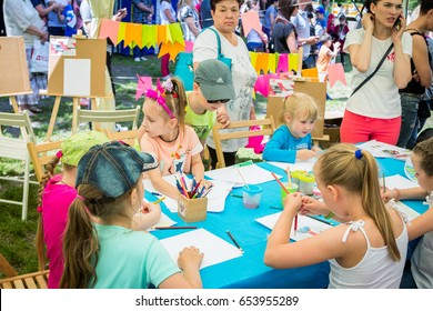 Zaporizhia/Ukraine- May 28, 2017: Charity Family festival:  art and craft outdoors workshop, children drawing by colorful pencils