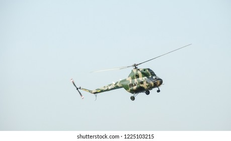 "Zaporizhzhia, Ukraine - Aug 18, 2018: Military transport helicopter ""Mil Mi-2"" (NATO reporting name Hoplite) isolated in the blue sky."