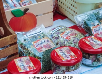 "Zaporizhzhia / Ukraine - SEP 16, 2018: pastila, candied fruit, tea (inscriptions ""homemade tea"", ""smakolyki""=goodies in ukrainian) of the ""All-Ukrainian Festival of Homemade Canning"" in Zaporozhye."