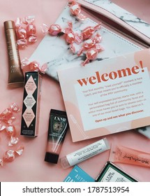 Zaporozhye, Ukraine - July 10 2020: Ipsy beauty box. Monthly make up products. There is a face mask, mascara, illumination cream and a lipstick in the picture.