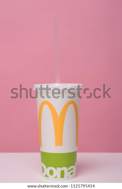 Zaporozhye, Ukraine - June 26th, 2018: A glass of McDonald's coctail on a pink background.