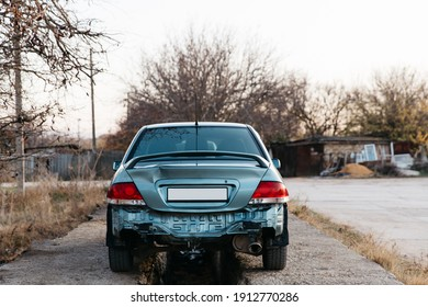 Zaporozhye, Ukraine- November 12 2019 :A car without a bumper, the exhaust pipe is visible. The trunk lid is dented. Auto after accident. Repair is needed. Car insurance concept