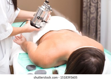 Zaporozhye, Ukraine. September 15, 2019. Beauty salon Prima Vera A cosmetologist doctor applies essential oils to the skin of a young woman. Relaxing treatments. Tanning. Spa treatments with Lucas