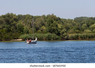 ZAPOROZHYE, UKRAINE-AUGUST 11: Sailing yacht���11, 2012 in Zaporozhye, Ukraine. Sailing yacht on the Dnieper River on the background of the island Khortytsya near the city Zaporozhye.